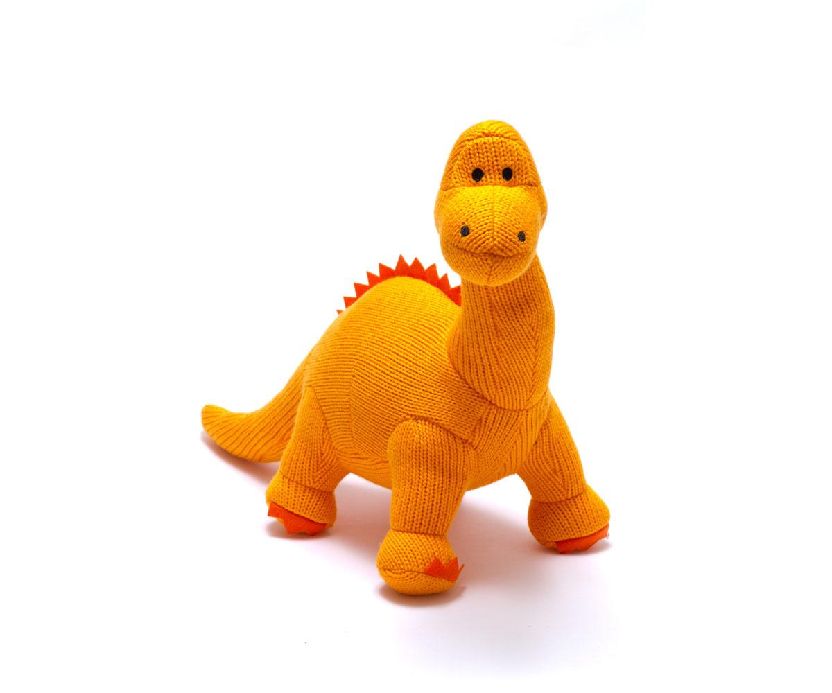 large dinosaur toy, knitted orange diplodocus