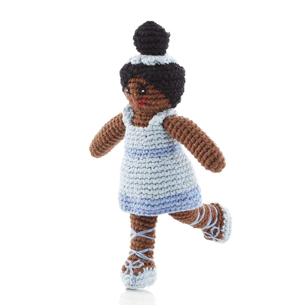 handmade and fair trade ballerina rattle in blue dress, blue ballet shoes with ribbons and dark skin