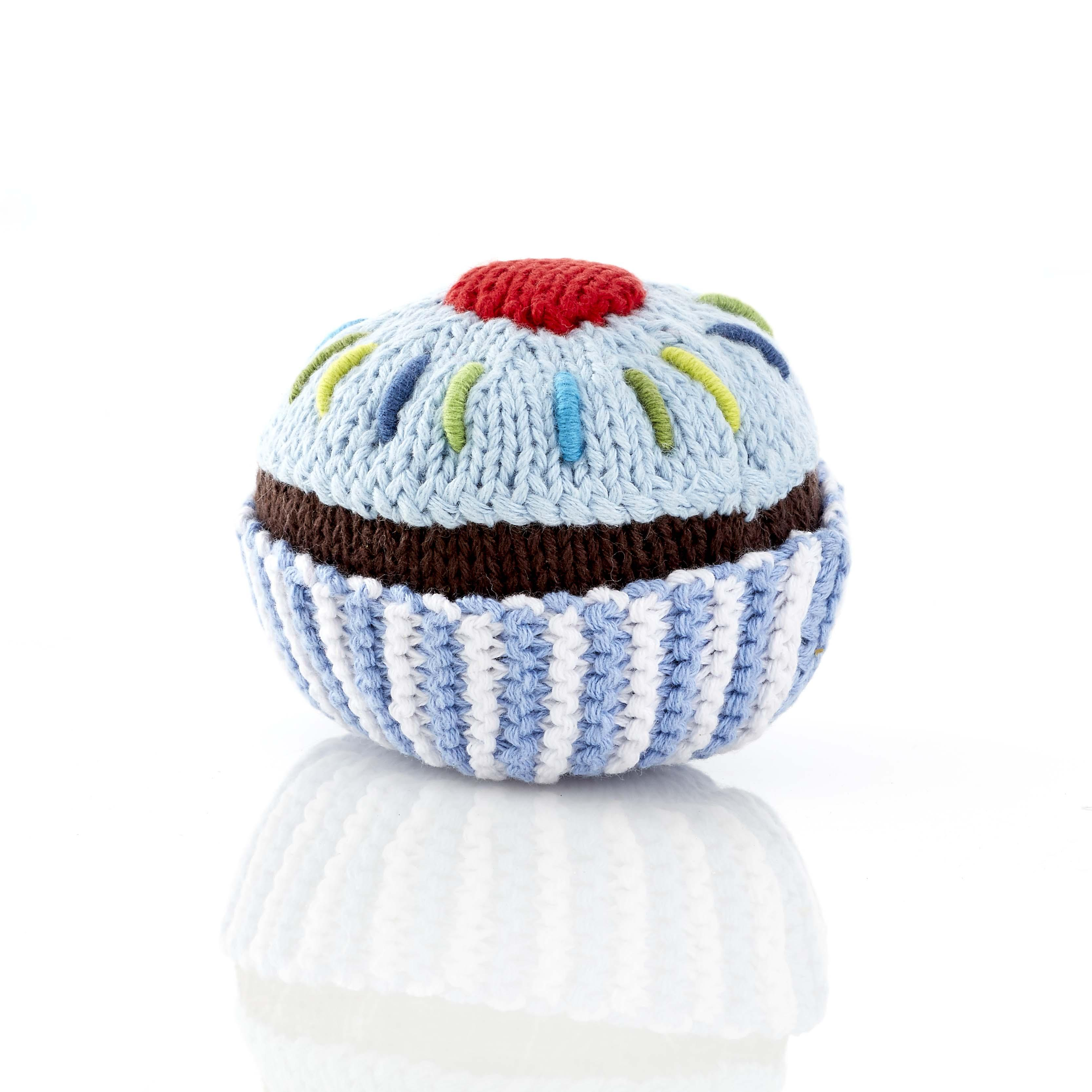 small blue cupcake baby rattle with pale blue icing and cherry on top