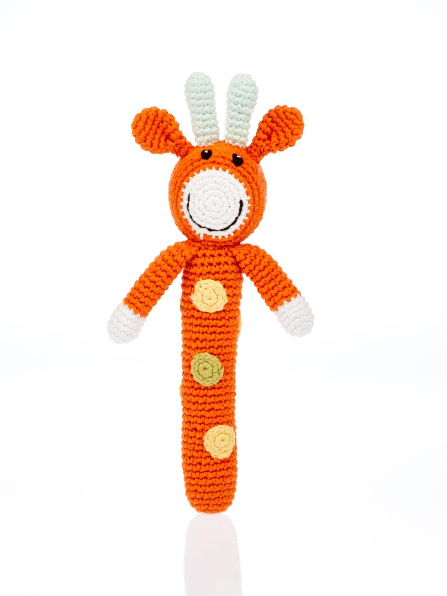 Orange giraffe stick shaped baby rattles with pale dots and smiley face