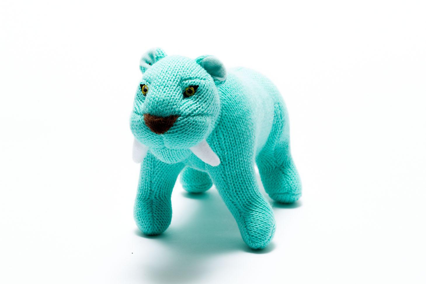 knitted turquoise small sabre tooth tiger dinosaur baby toy with rattle