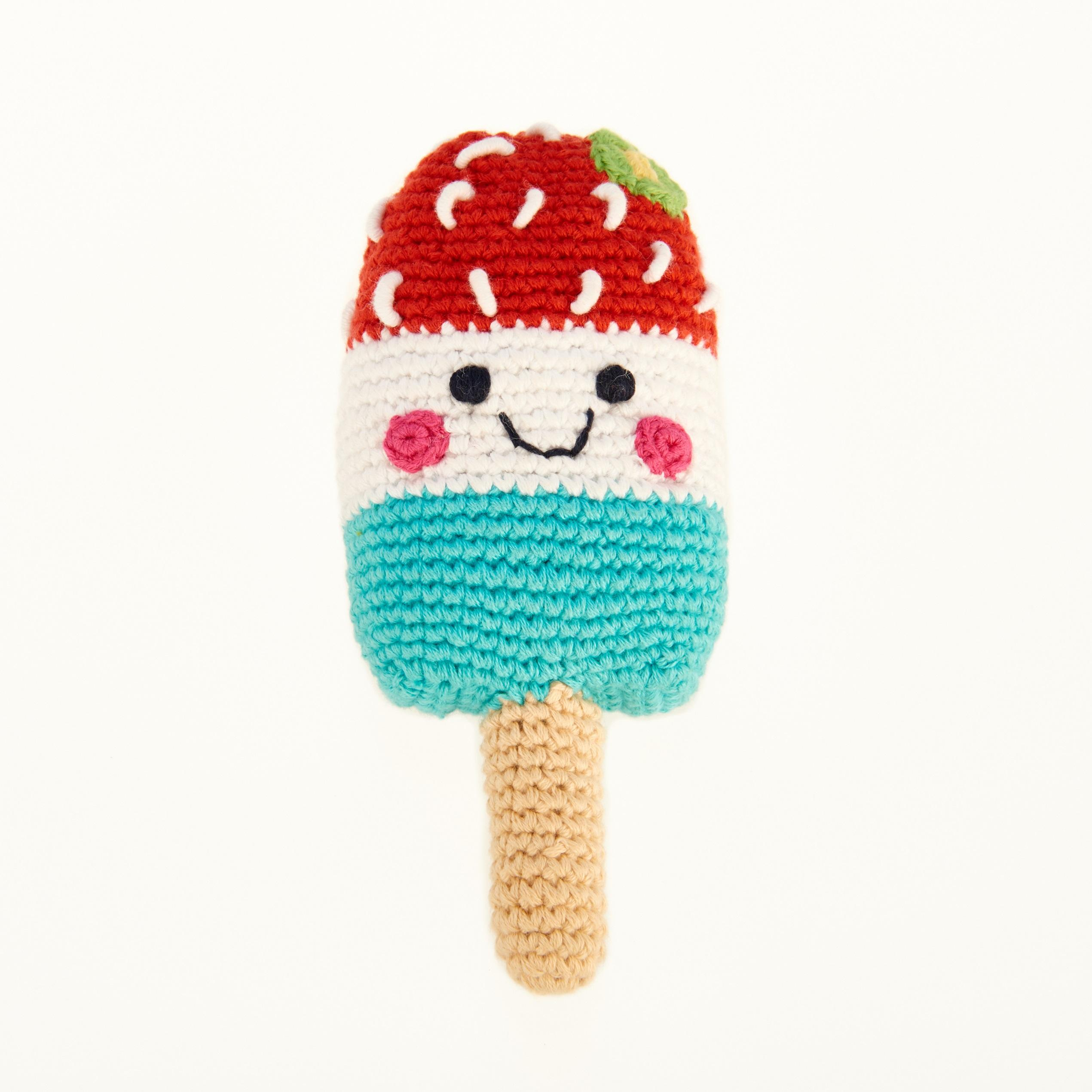 Ice lolly baby toy, crochet in blue, white and red with a smiley face and sprinkles