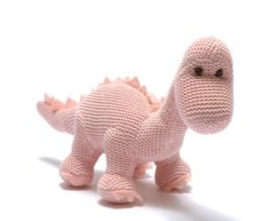 Pastel pink knitted diplodocus dinosaur baby toy with long neck.