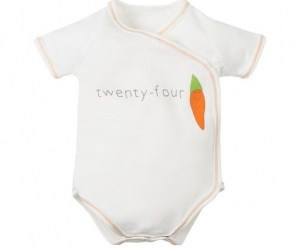 Organic white cotton short sleeve side snap baby body with twenty four carrot sloagn on front