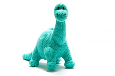 Knitted diplodocus dinosaur soft toy in ice blue colour with long neck and tail and smiley face
