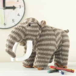Greetings card featuring woolly mammoth knitted soft toys with crayons in front and clock behind