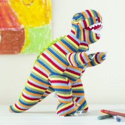 Greetings card featuring stripe knitted T Rex soft toy with crayons on floor and painting behind