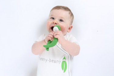 Organic white cotton short sleeve side snap baby body with teent beany slogan on front