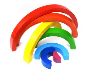 Wooden rainbow toy cut in 7 pieces of wood that fit together into a puzzle
