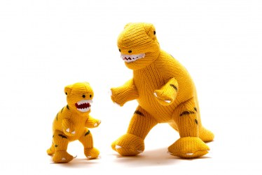 yellow t rex toy and rattle