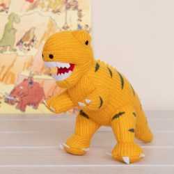 yellow t rex with painting