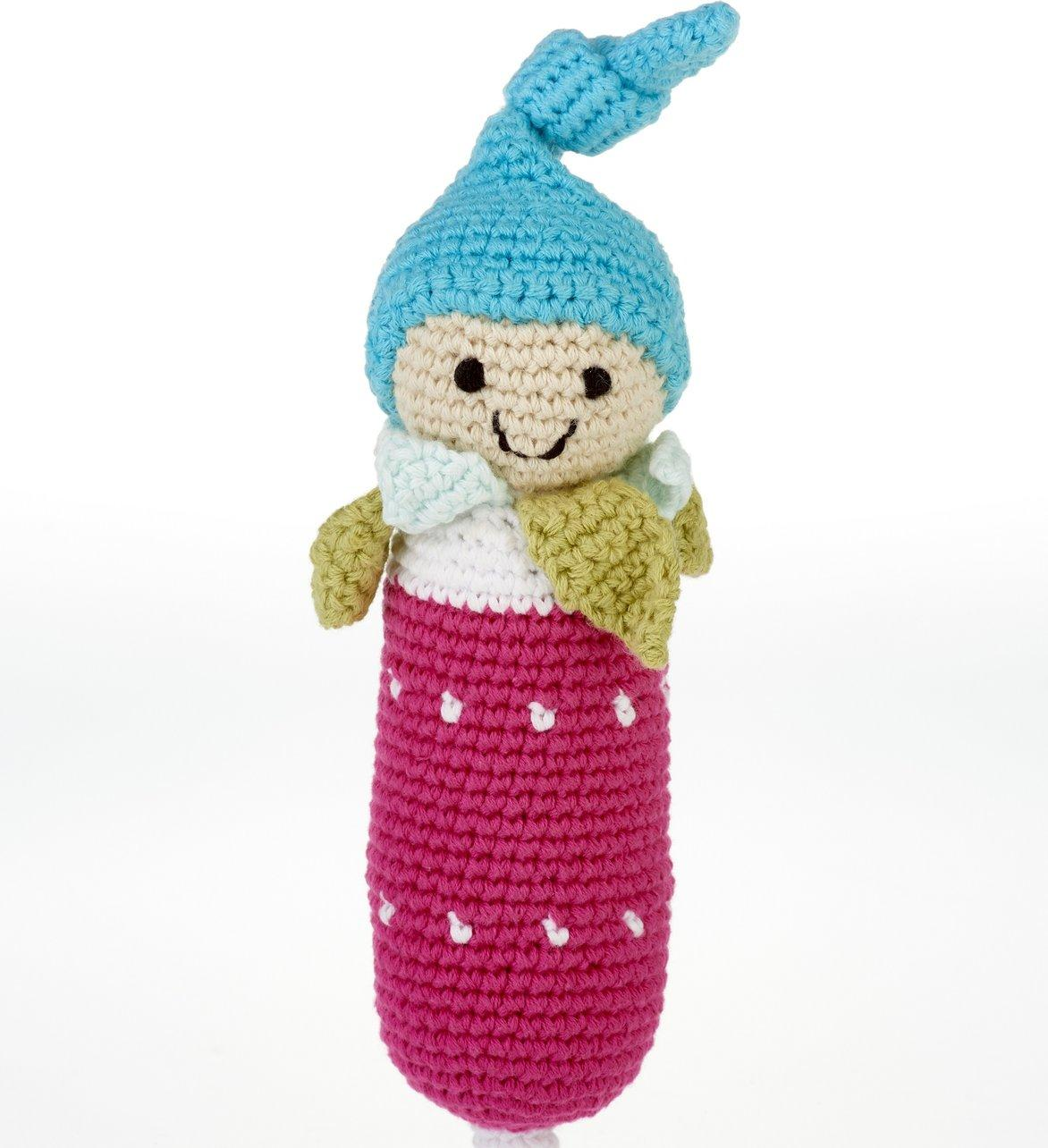 Pink radish baby toy with smiley face and blue bobble hat