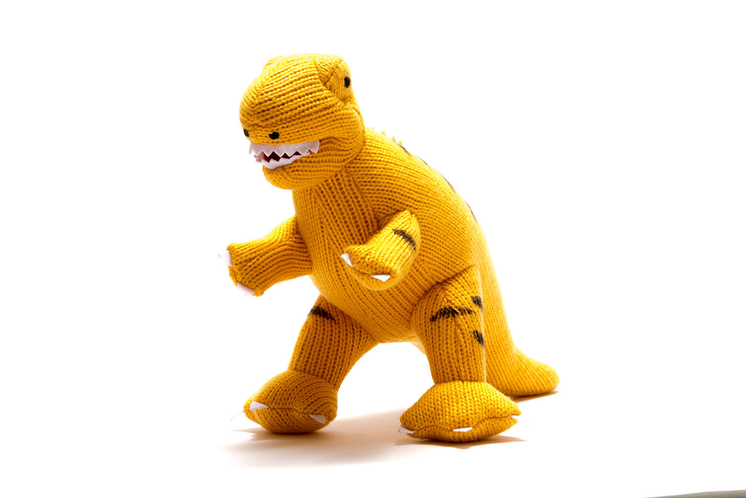 Yellow knitted T Rex dinosaur soft toy with white jagged teeth